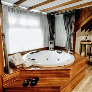 Wooden Frame Jet Tub in Bathroom