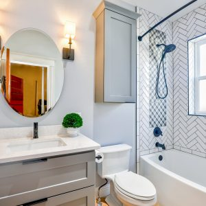 Oval Mirror in Bathroom